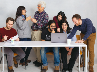 a group of people at a table collaborating