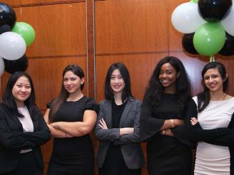 Five female Stern students at the USWIB Conference