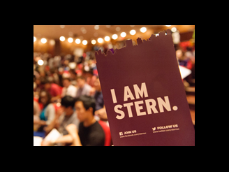 I am Stern logo in front of incoming class of students