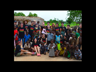 Stern students posing with children of Ghana