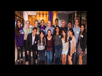 Group of returning Stern alumni posing during event