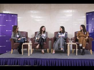 Four women talking together on panel at Stern