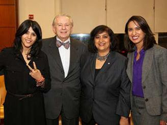 Dean Menon posing with Etka Kapoor and two students