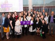 Dean Menon and Stern Undergraduate College Team pose with I am Stern sign