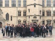 A group of students stands in front of Kronborg Castle
