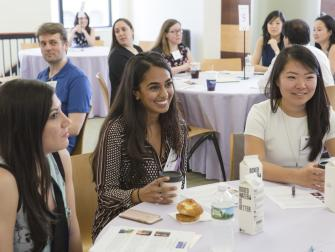 Alumni gather at a women's panel during Stern Reunion