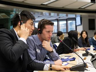 Matt Robinson and other students in the European Union with headsets on