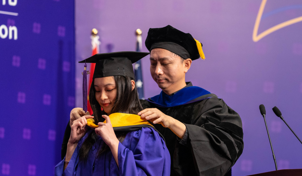 Graduating student and faculty member