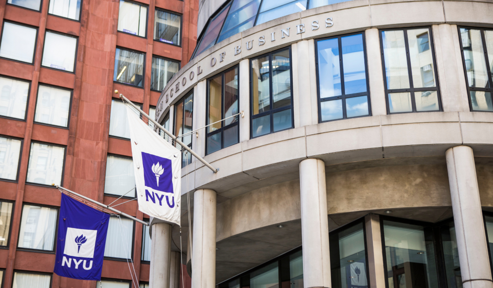 Front of NYU Stern Tisch and KMC buildings with flags