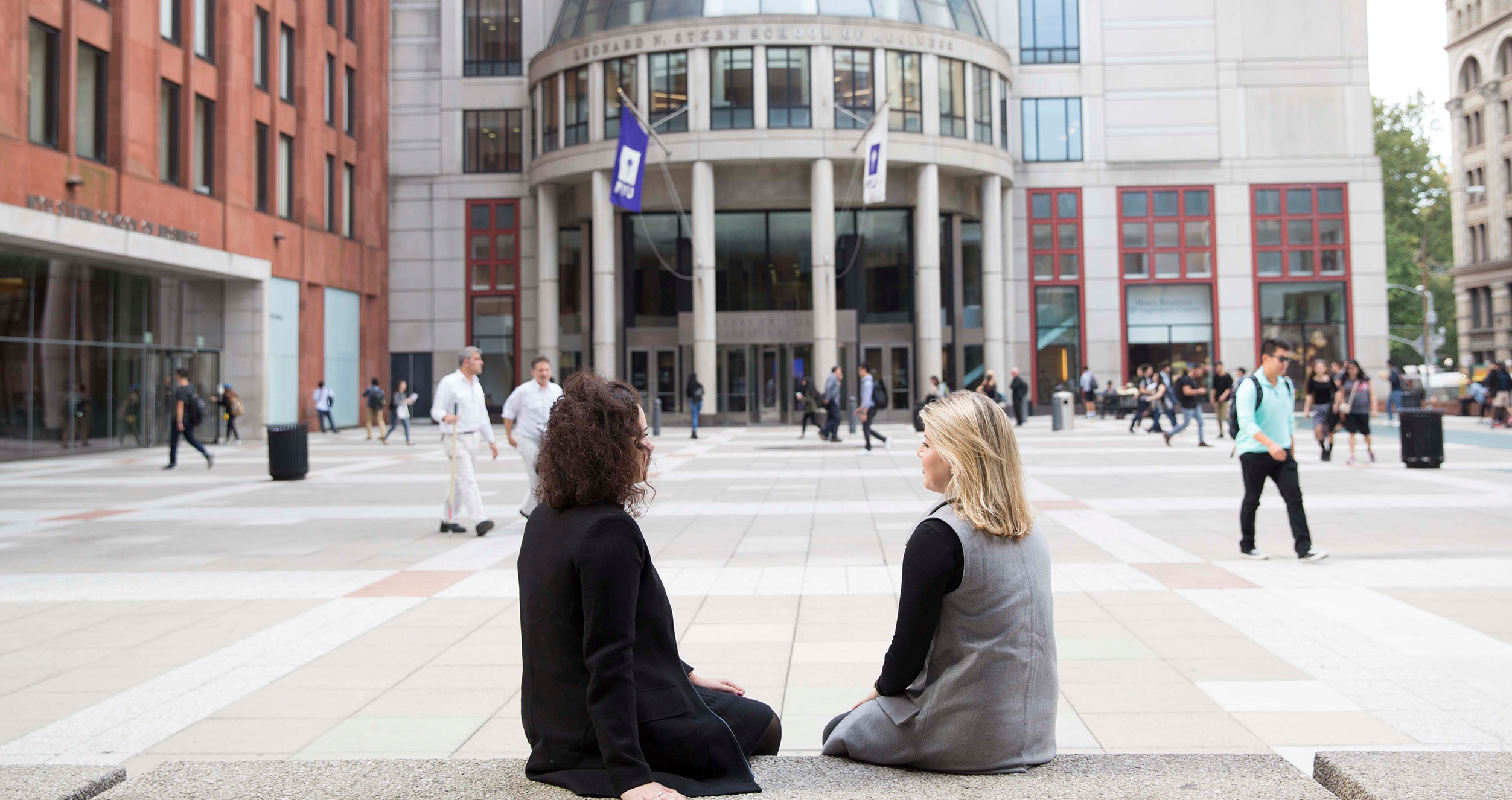 Two Women Sitting on Gould Plaza