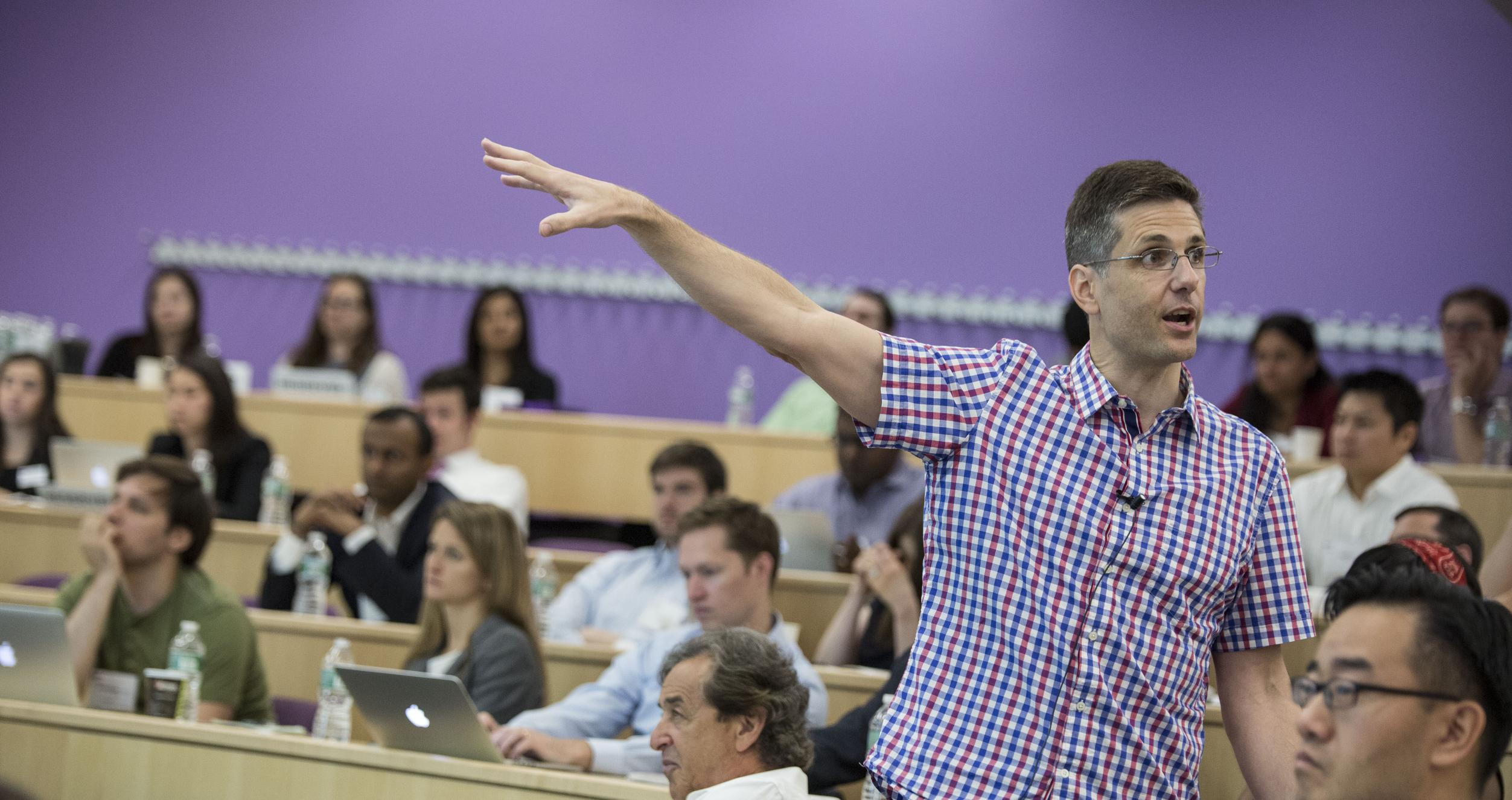 JP Eggers, Dean of MBA Programs, lectures in a classroom