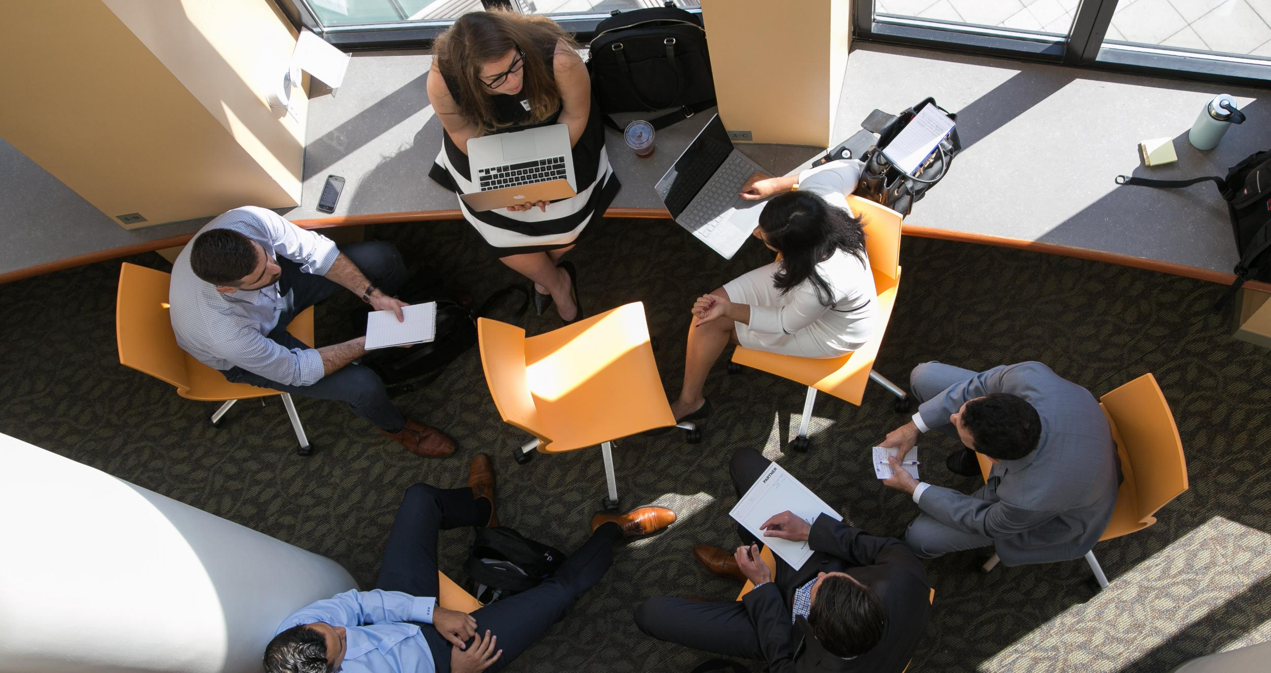 Photo from above of six students working