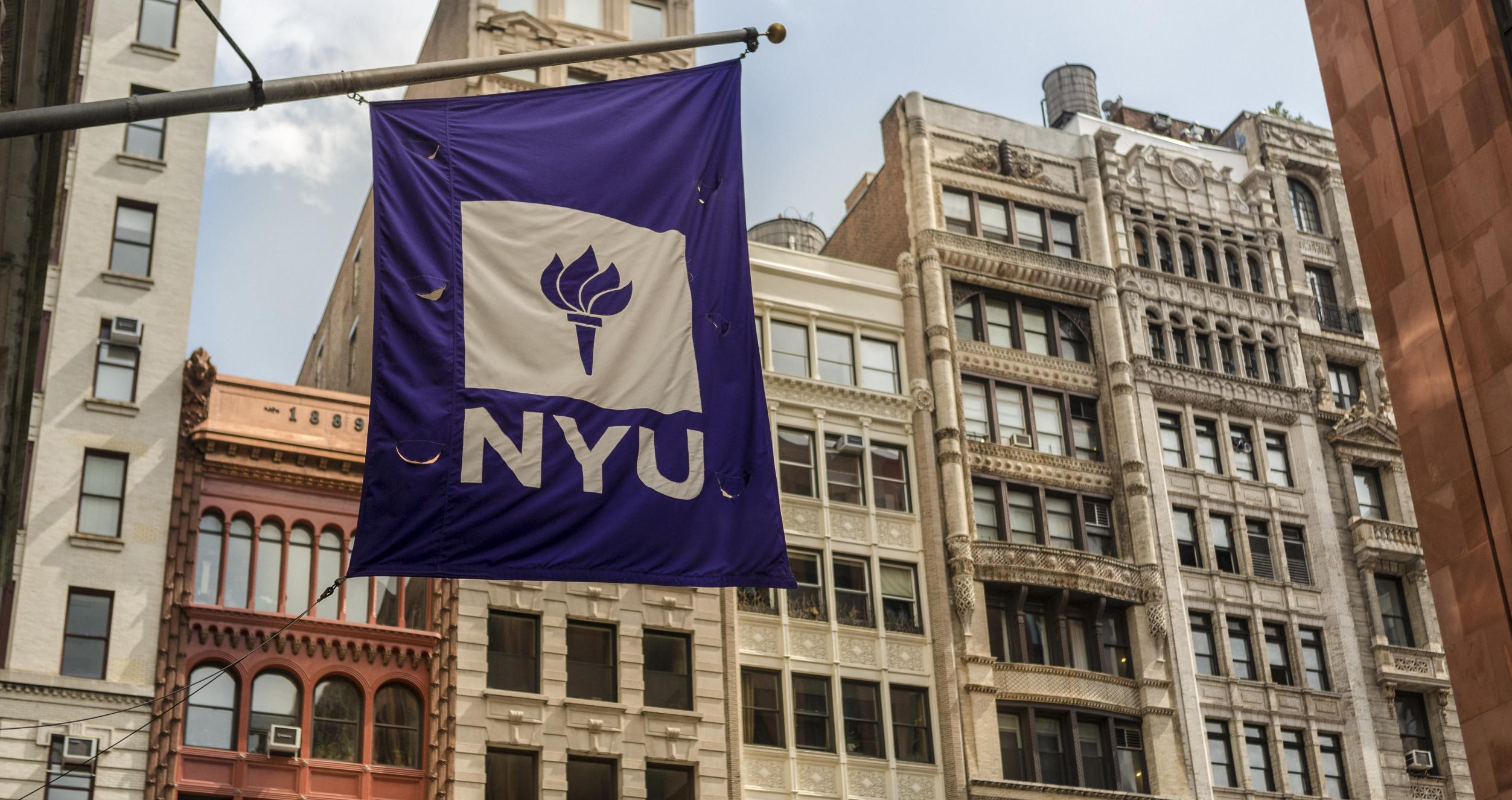 NYU flag against cityscape