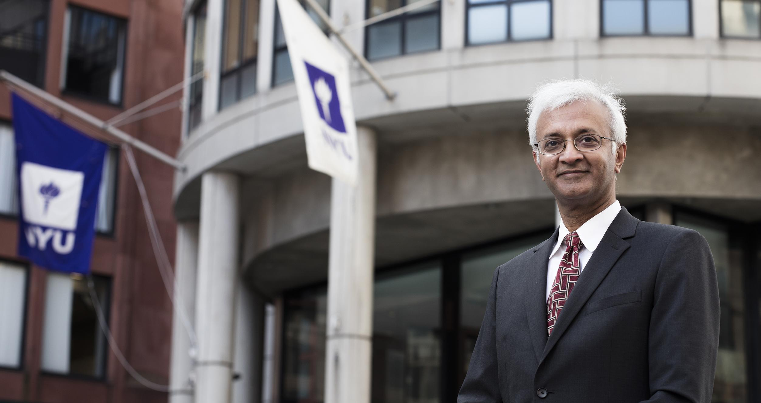 Raghu Sundaram standing in front of Kaufman Management Center