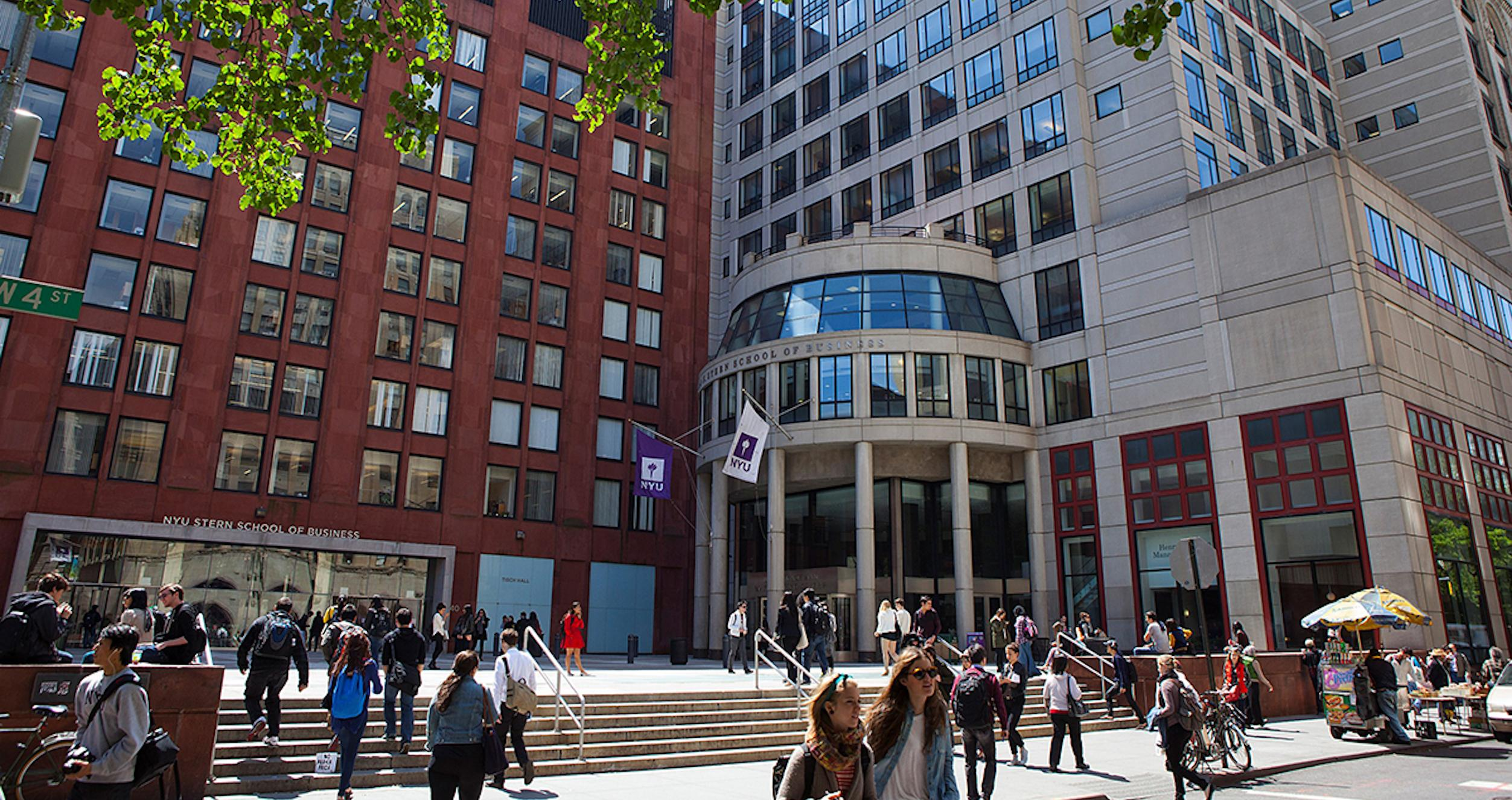 Students walking around Gould Plaza on West 4th Street at NYU Stern