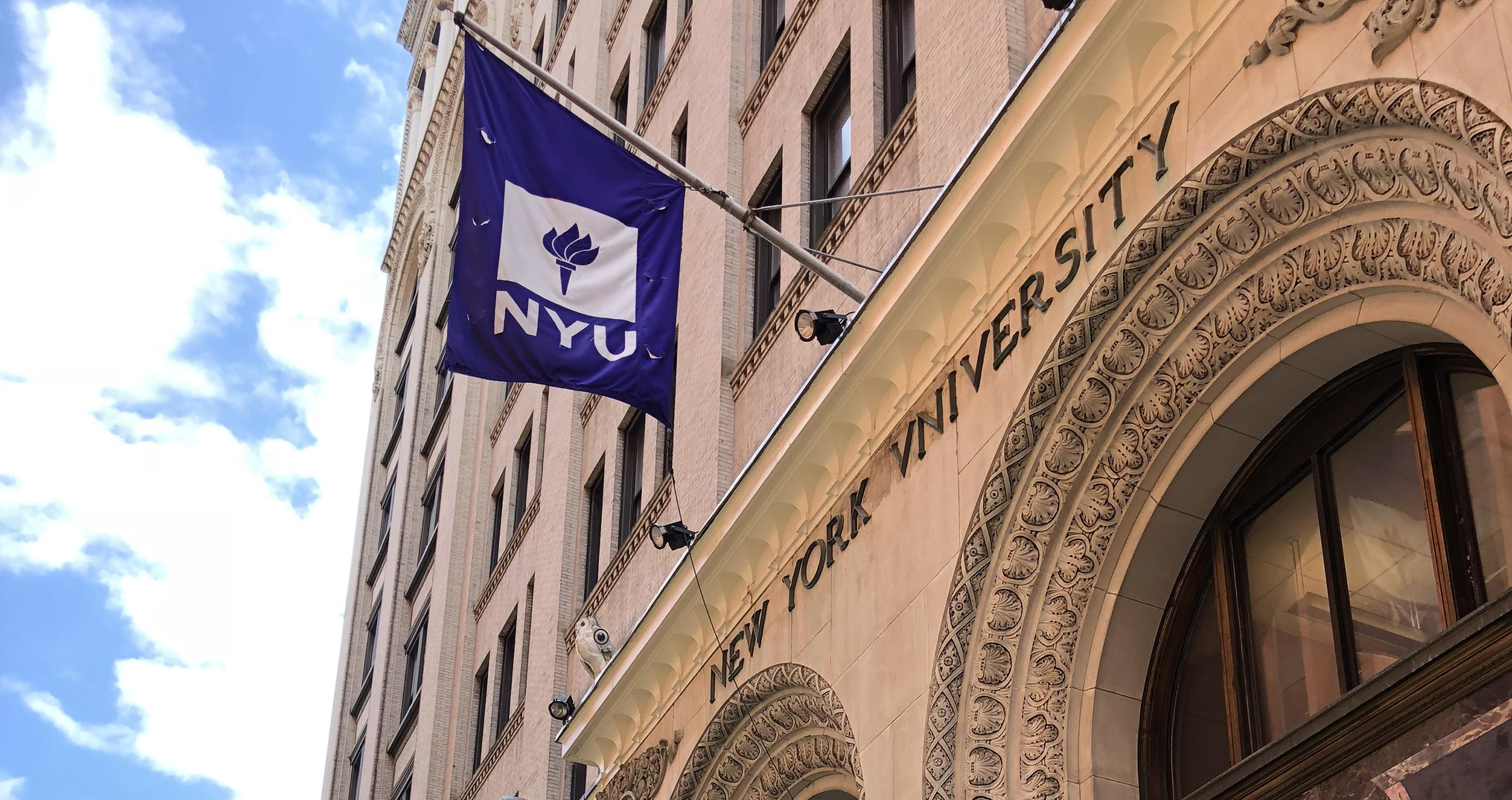 Back of KMC with NYU Flag