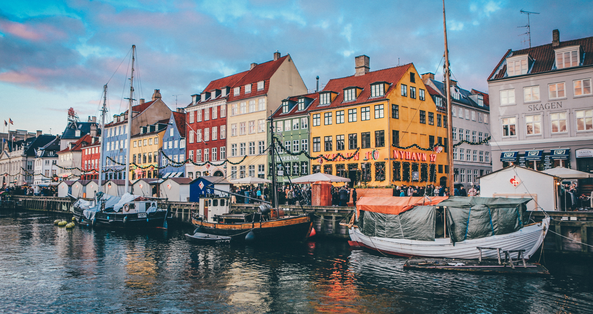 Buildings and boats line a channel in Copenhagen