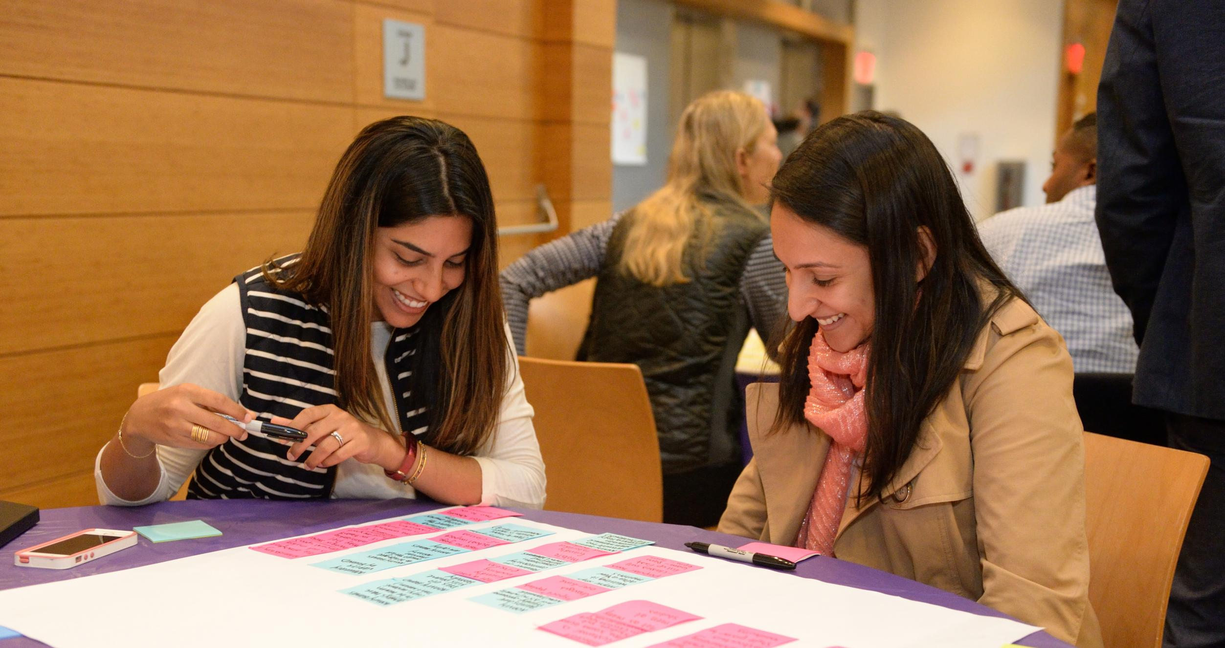 students collaborating at a table