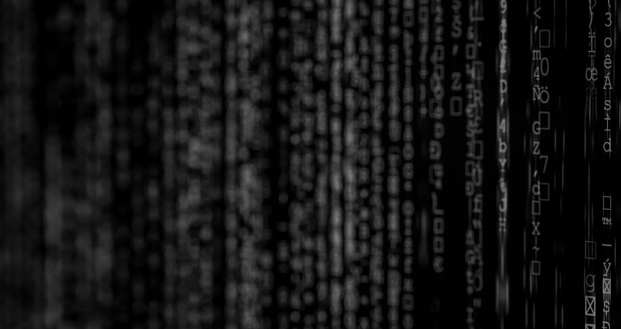 Abstract image of black screen with white code