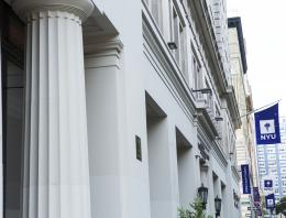 Column of a building and NYU flag