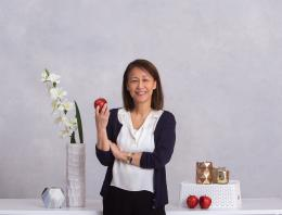 This is an image of a founder holding an apple for a professional photo.