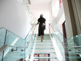 Woman walking up staircase