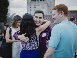 Alumni gather at an Outclass rooftop soiree
