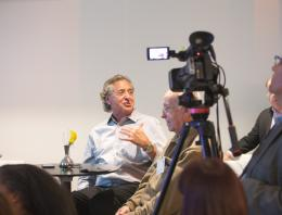 Harry Chernoff speaking and being recorded by a camera