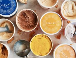 Variety of open and closed pints of Malai ice cream viewed from above