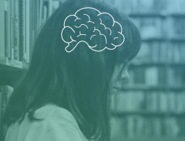 Student reads in library, a brain is illustrated over her head