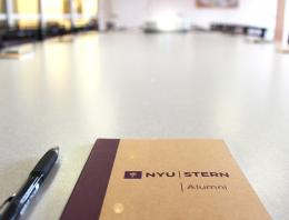 Alumni Council notebook on a conference table
