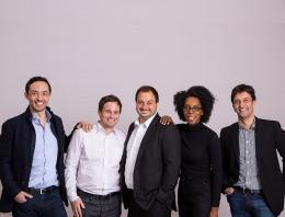 This is an image of five founders standing together.