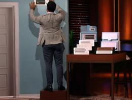 Man adjusting a vent on a fake wall as part of a demonstration