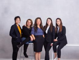 This is a photo of five female founders in business formal clothing.