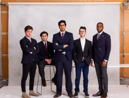This is a photo of five male founders all in suit jackets.