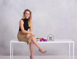This is a photo of a female founder sitting at a table.