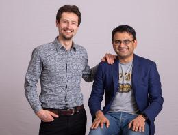 This is a photo of two male founders posing for a portrait.