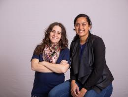 Two female founders standing for a professional team photo.