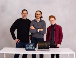 This is an image of the Autotoon team with three male founders at a white table.