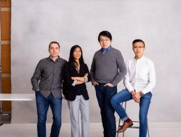 This is an image of the React Power team including three males and one female in front of a blank background.