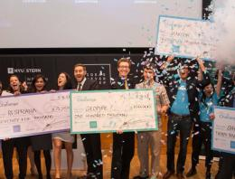 NYU Stern teams hold their checks and celebrate at the 300k Challenge Awards