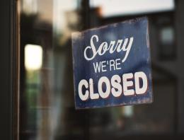 sorry we're closed sign posted on door