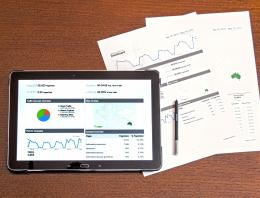 digital and paper business analysis charts