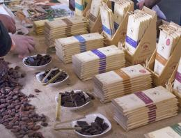 Table of wrapped chocolate bars and small pieces of chocolate samples