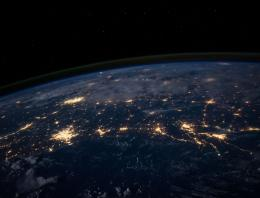 Photo of earth from outer space with cities lit up by electrical lights