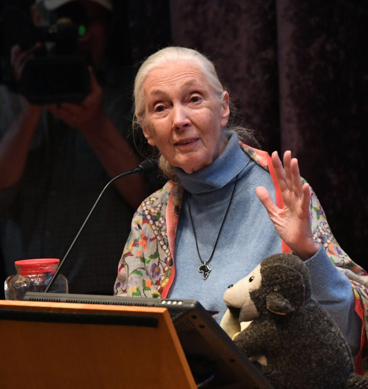Jane Goodall speaking at a podium