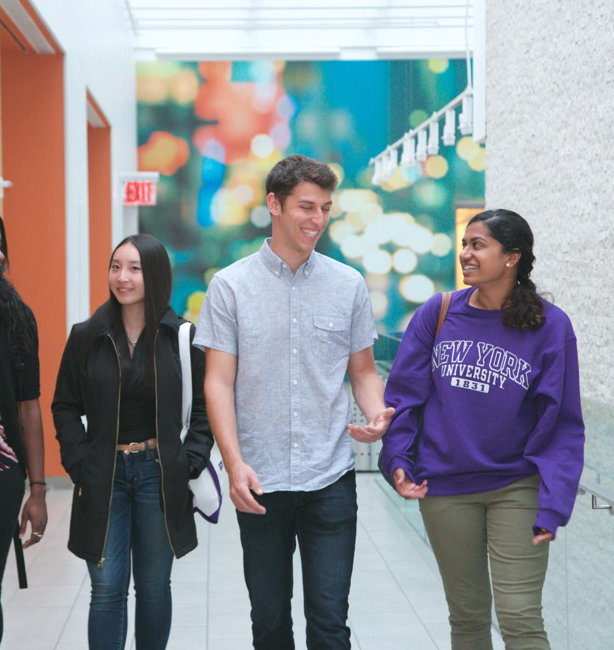 Students walking down the hall of Tisch