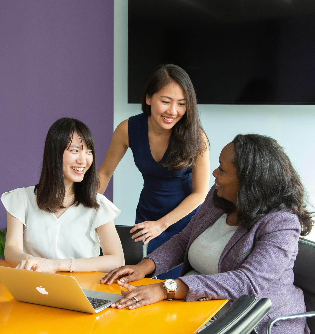 3 women in a conference room