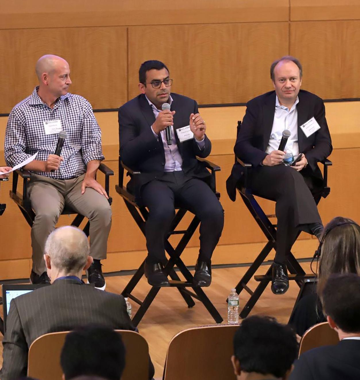 Panelists speaking at the FinTech conference