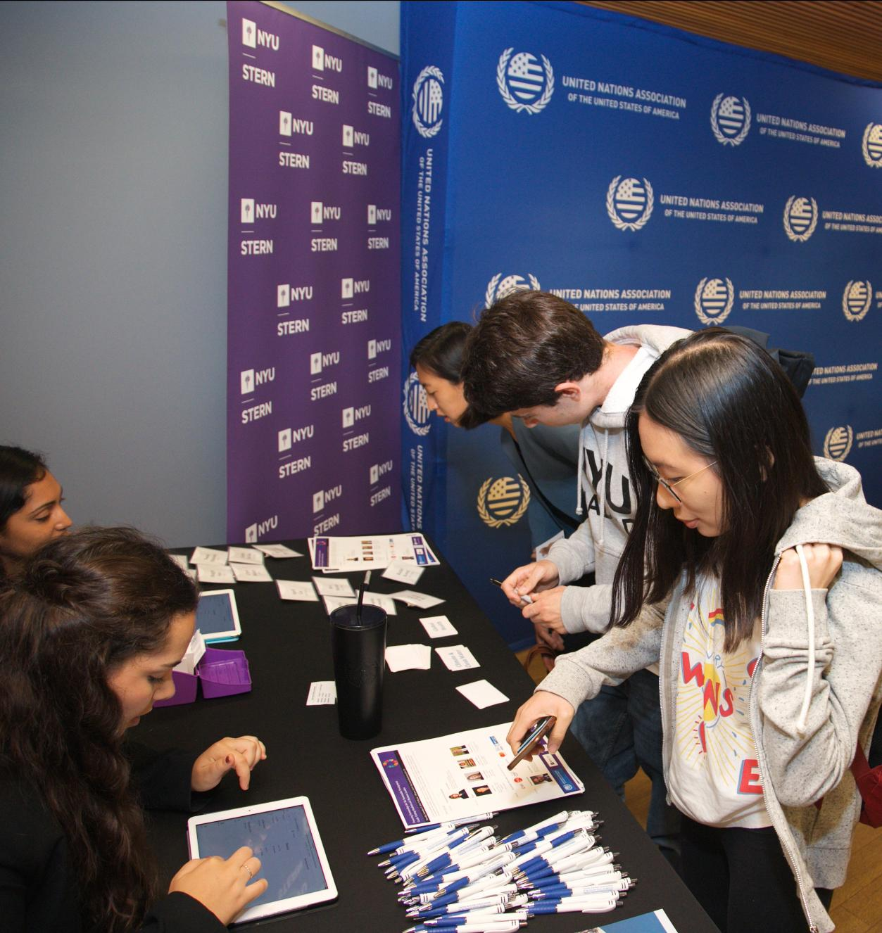 Students checking in at a table for an event